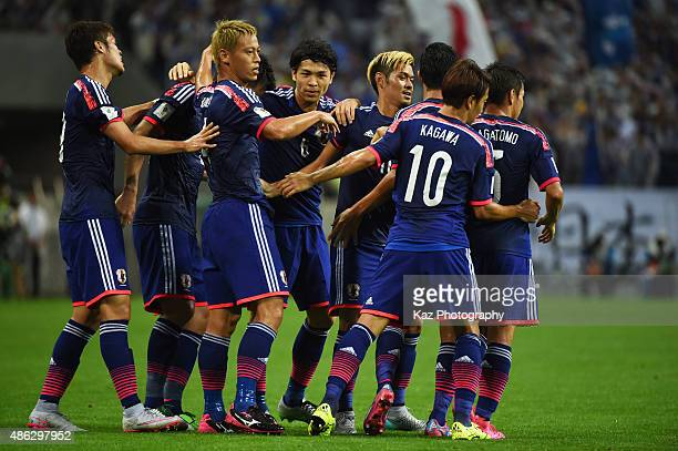 Keisuke Honda of Japan celebrates the opener with his team mates during the 2018 FIFA World Cup Qualifier Round 2 Group E at Saitama Stadium on...