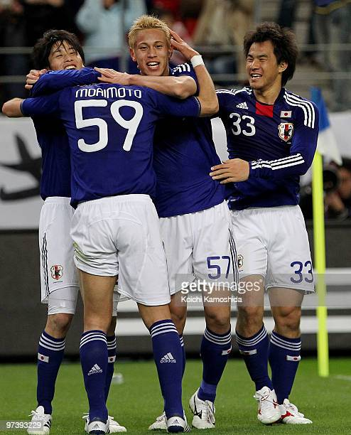 Keisuke Honda of Japan celebrates with his team mates after scoring his team's second goal during the AFC Asian Cup Qatar 2011 Group A qualifier...