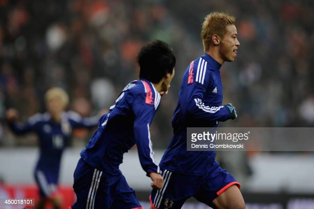 Keisuke Honda of Japan celebrates with teammates after scoring his team's second goal during the International Friendly match between the Netherlands...