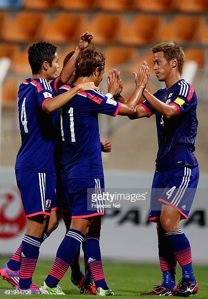 Keisuke Honda of Japan celebrates with teammates after scoring his team's second goal during the 2018 FIFA World Cup Asian Group E qualifying match...