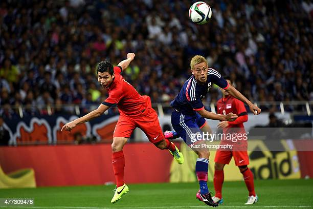 Keisuke Honda of Japan competes for the ball with Mohamad Shaiful Bin Esah Nain of Singapore during the 2018 FIFA World Cup Asian Qualifier second...