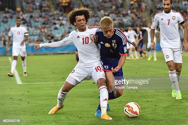 Keisuke Honda of Japan competes with Omar Abdulrahman of the United Arab Emirates during the 2015 Asian Cup Quarter Final match between Japan and the...