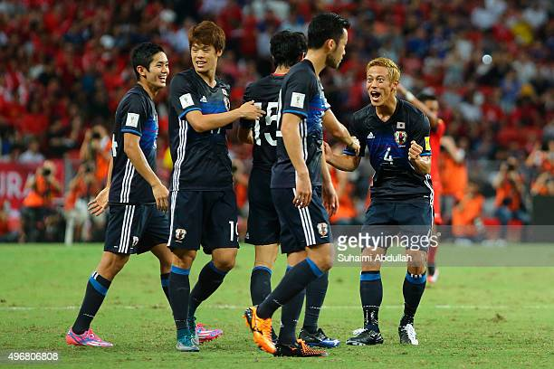 Keisuke Honda of Japan congratulates Mu Kanazaki after scoring the first goal during the 2018 FIFA World Cup Qualifier match between Singapore and...