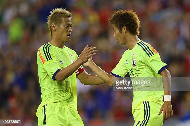 Keisuke Honda of Japan congratulates Yoichiro Kakitani of Japan after scoring a goal during the International Friendly Match between Japan and Costa...