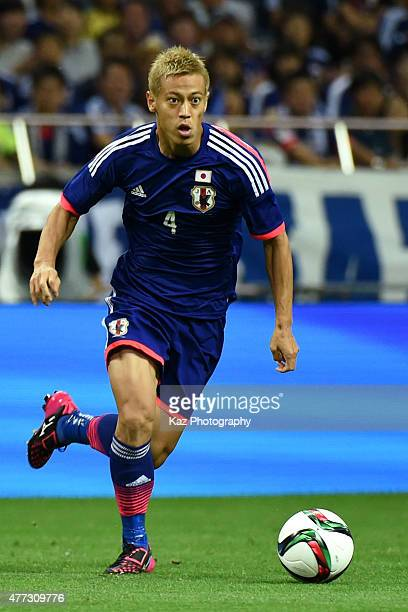 Keisuke Honda of Japan dribbles the ball during the 2018 FIFA World Cup Asian Qualifier second round match between Japan and Singapore at Saitama...