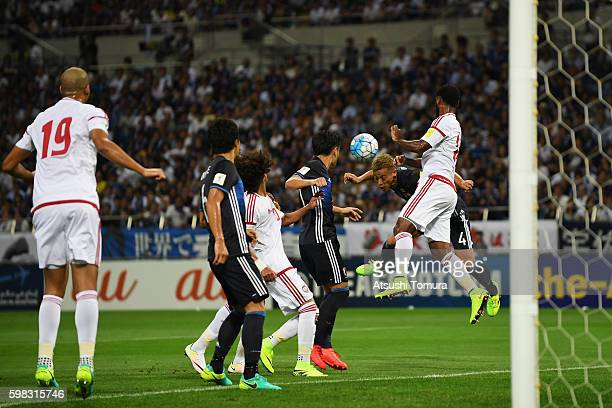 Keisuke Honda of Japan heads the ball to score his team's first goal during the 2018 FIFA World Cup Qualifier Final Round Group B match between Japan...