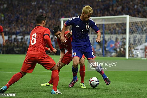 Keisuke Honda of Japan in action during the 2018 FIFA World Cup Asian Qualifier second round match between Japan and Singapore at Saitama Stadium on...