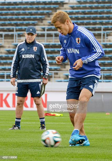 Keisuke Honda of Japan in action while head coach Javier Aguirre watches during a training session at JFA's Sakai Training Center on November 16 2014...