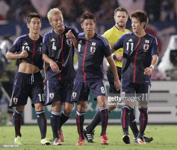 Keisuke Honda of Japan is congratulated after scoring a goal during the international friendly match between Japan and Ghana at International Stadium...