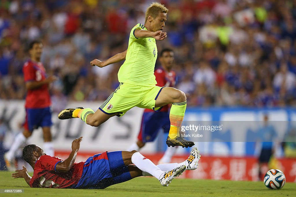 <a gi-track='captionPersonalityLinkClicked' href=/galleries/search?phrase=Keisuke+Honda&family=editorial&specificpeople=2333022 ng-click='$event.stopPropagation()'>Keisuke Honda</a> of Japan is tackled by Junior Diaz of Costa Rica during the International Friendly Match between Japan and Costa Rica at Raymond James Stadium on June 2, 2014 in Tampa, Florida.