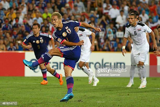 Keisuke Honda of Japan kicks a penalty goal during the 2015 Asian Cup match between Iraq and Japan at Suncorp Stadium on January 16 2015 in Brisbane...