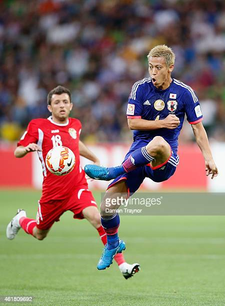 Keisuke Honda of Japan kicks the ball during the 2015 Asian Cup match between Japan and Jordan at AAMI Park on January 20 2015 in Melbourne Australia