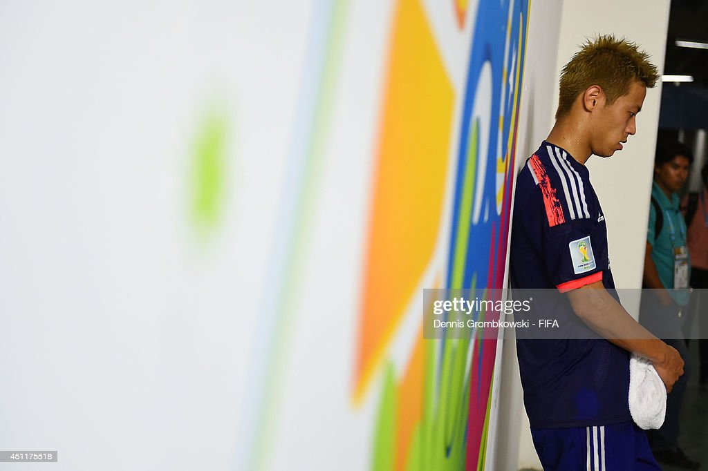 Keisuke Honda of Japan looks dejected in the tunnel after 1-4 defeat in the 2014 FIFA World Cup Brazil Group C match between Japan and Colombia at Arena Pantanal on June 24, 2014 in Cuiaba, Brazil.