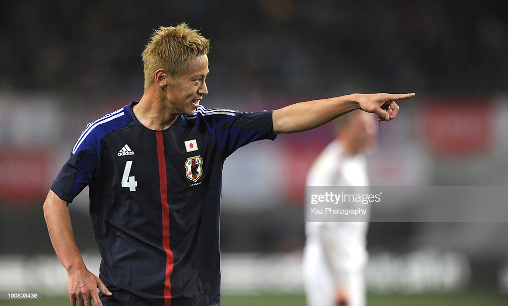 <a gi-track='captionPersonalityLinkClicked' href=/galleries/search?phrase=Keisuke+Honda&family=editorial&specificpeople=2333022 ng-click='$event.stopPropagation()'>Keisuke Honda</a> of Japan pointed out Shinji Kagawa of Japan who assists his goal during the international friendly match between Japan and Latvia at Home's Stadium Kobe on February 6, 2013 in Kobe, Japan.
