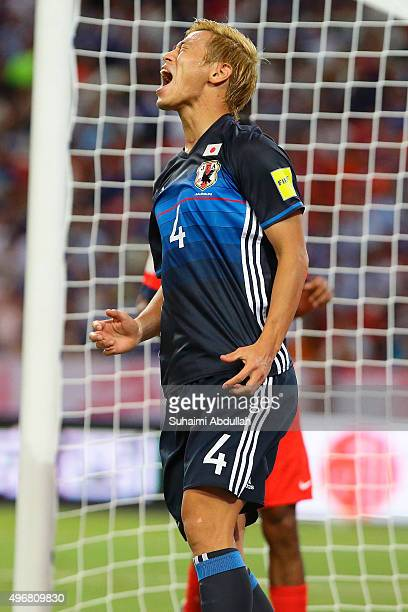 Keisuke Honda of Japan reacts after missing a goal during the 2018 FIFA World Cup Qualifier match between Singapore and Japan at National Stadium on...