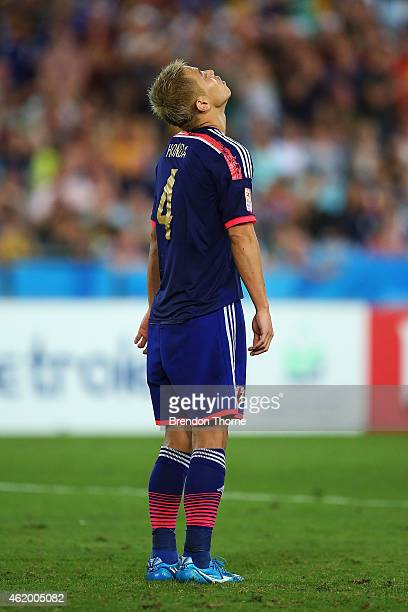Keisuke Honda of Japan reacts after missing a goal in the penalty shoot out during the 2015 Asian Cup Quarter Final match between Japan and the...