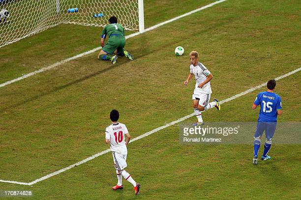 Keisuke Honda of Japan reacts after scoring the opening goal from a penalty past Gianluigi Buffon of Italy during the FIFA Confederations Cup Brazil...