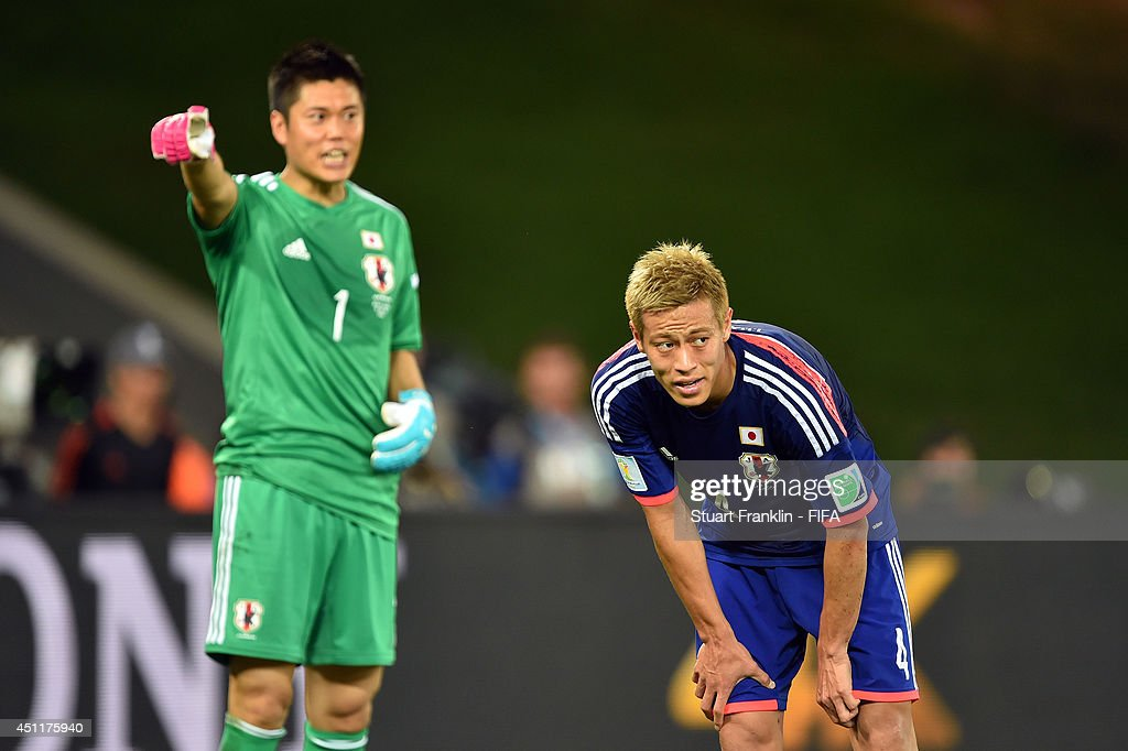 <a gi-track='captionPersonalityLinkClicked' href=/galleries/search?phrase=Keisuke+Honda&family=editorial&specificpeople=2333022 ng-click='$event.stopPropagation()'>Keisuke Honda</a> of Japan reacts during the 2014 FIFA World Cup Brazil Group C match between Japan and Colombia at Arena Pantanal on June 24, 2014 in Cuiaba, Brazil.