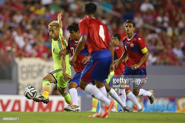 Keisuke Honda of Japan runs the ball during the International Friendly Match between Japan and Costa Rica at Raymond James Stadium on June 2 2014 in...