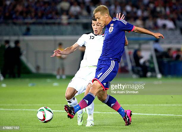 Keisuke Honda of Japan scores his team's first goal during the international friendly match between Japan and Iraq at Nissan Stadium on June 11 2015...