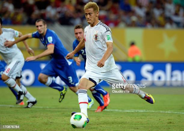 Keisuke Honda of Japan scores the opening goal from a penalty during the FIFA Confederations Cup Brazil 2013 Group A match between Italy and Japan at...