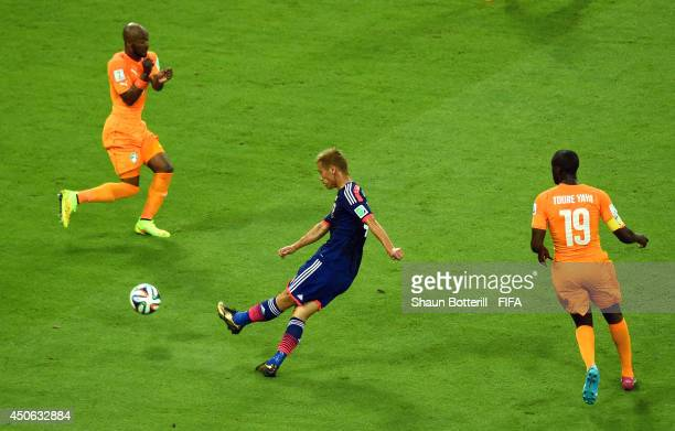 Keisuke Honda of Japan scores the team's first goal during the 2014 FIFA World Cup Brazil Group C match between Cote D'Ivoire and Japan at Arena...
