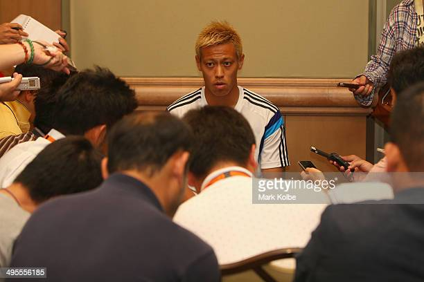 Keisuke Honda of Japan speaks to the press during a media session at the Hyatt Regency Clearwater Beach Resort and Spa on June 4 2014 in Clearwater...