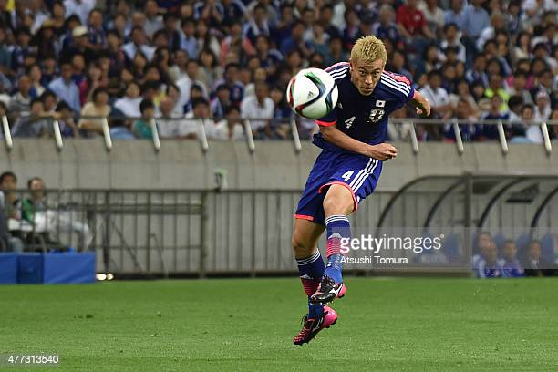 Keisuke Honda of Japan takes a shot during the 2018 FIFA World Cup Asian Qualifier second round match between Japan and Singapore at Saitama Stadium...