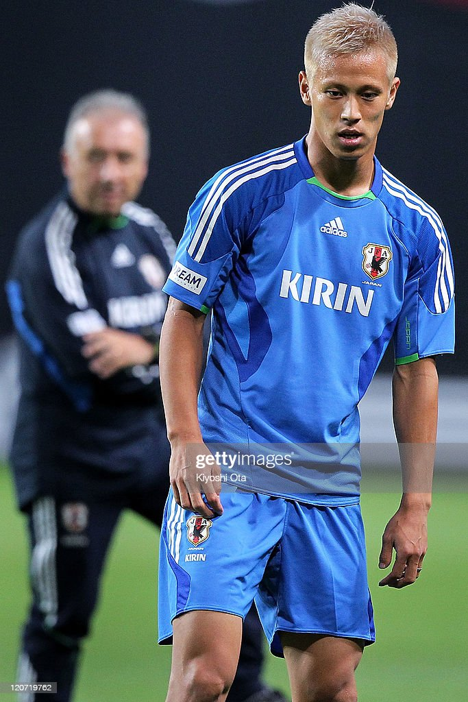 Keisuke Honda (R) of Japan takes part in the Japan national team training session ahead of the Kirin Challenge Cup international friendly match against South Korea at Sapporo Dome on August 9, 2011 in Sapporo, Japan.
