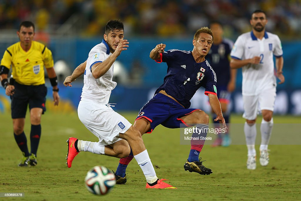 Keisuke Honda of Japan threads a pass during the 2014FIFA World Cup Group C match between Japan and Greece at Estadio das Dunas on June 19, 2014 in Natal, Brazil.