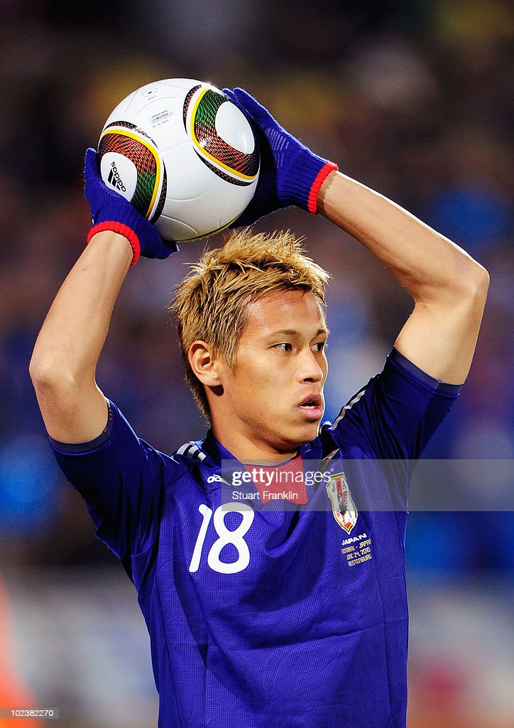 Keisuke Honda of Japan throws the ball in during the 2010 FIFA World Cup South Africa Group E match between Denmark and Japan at the Royal Bafokeng...