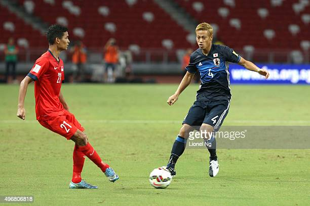 Keisuke Honda of Japan tries to get the ball past Muhammad Safuwan of Singapore during the 2018 FIFA World Cup Qualifier match between Singapore and...