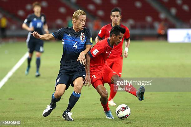 Keisuke Honda of Japan tries to win the ball from Muhammad Shakir of Singapore during the 2018 FIFA World Cup Qualifier match between Singapore and...