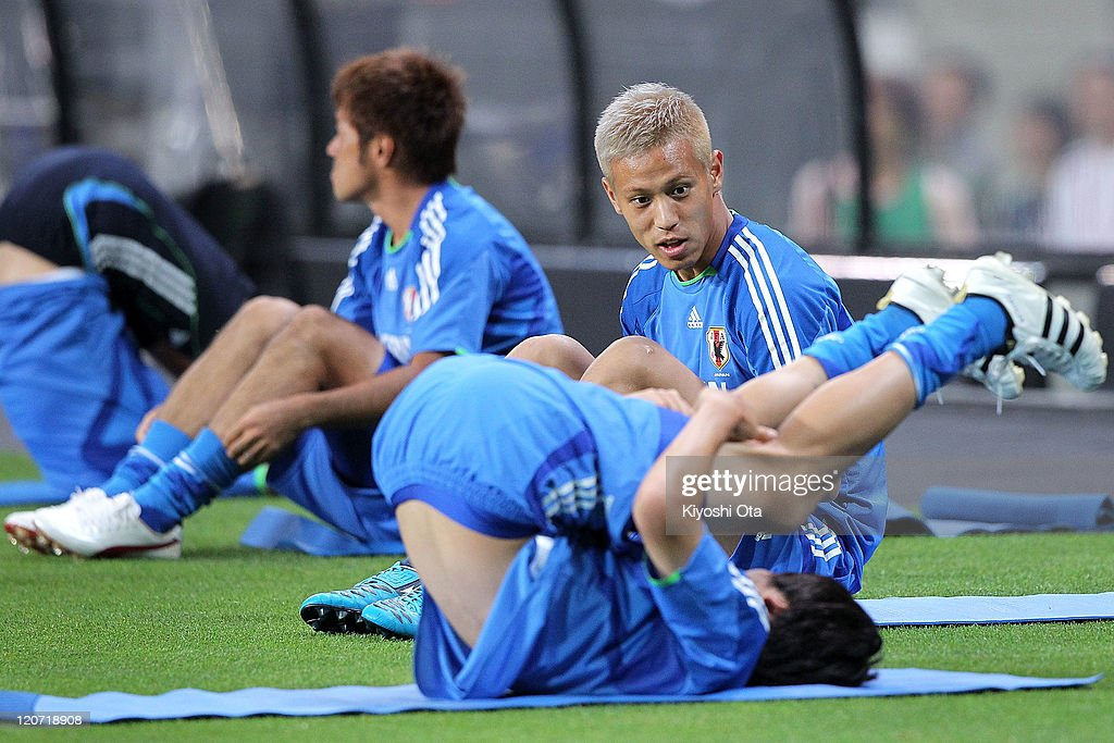 Keisuke Honda of Japan warms up during the Japan national team training session ahead of the Kirin Challenge Cup international friendly match against South Korea at Sapporo Dome on August 9, 2011 in Sapporo, Japan.