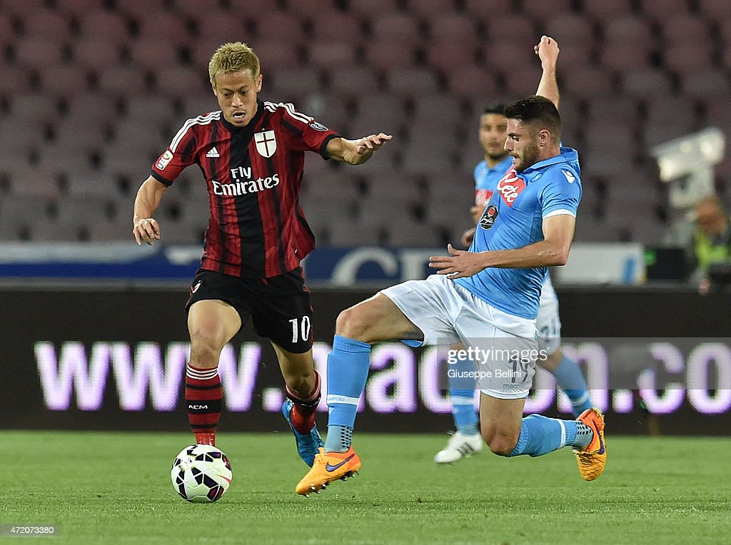 Keisuke Honda of Milan and David Lopez of Napoli in action during the Serie A match between SSC Napoli and AC Milan at Stadio San Paolo on May 3, 2015 in Naples, Italy.
