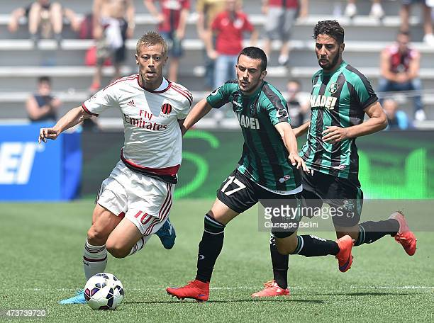Keisuke Honda of Milan and Nicola Sansone of Sassuolo in action during the Serie A match between US Sassuolo Calcio and AC Milan on May 17 2015 in...