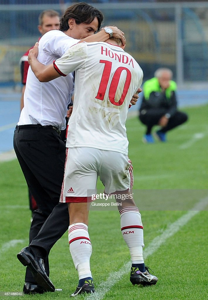 Keisuke Honda of Milan celebrates with Filippo Inzaghi head coach of Milan after scoring a goal to make it 0-3 during the Serie A match between Hellas Verona FC and AC Milan at Stadio Marc'Antonio Bentegodi on October 19, 2014 in Verona, Italy.