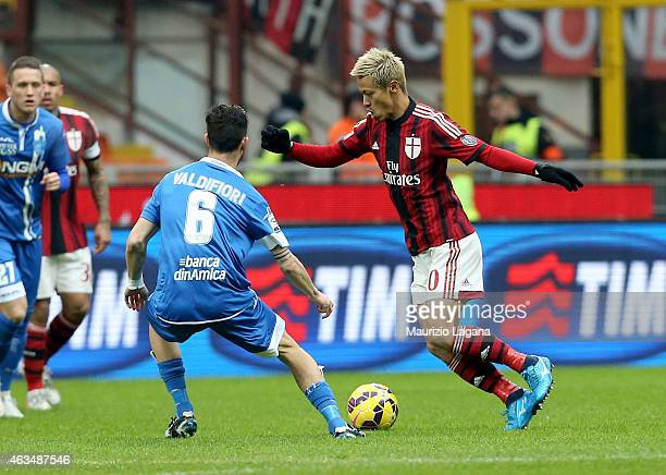Keisuke Honda of Milan competes for the ball with Mirko Valdifori of Empoli during the Serie A match between AC Milan and Empoli FC at Stadio...