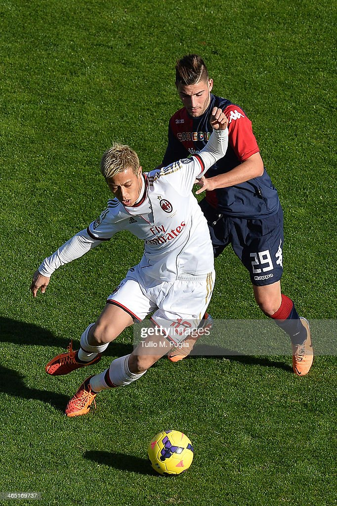 Keisuke Honda (L) of Milan Nicola Murru of Cagliari compete for the ball during the Serie A match between Cagliari Calcio and AC Milan at Stadio Sant'Elia on January 26, 2014 in Cagliari, Italy.