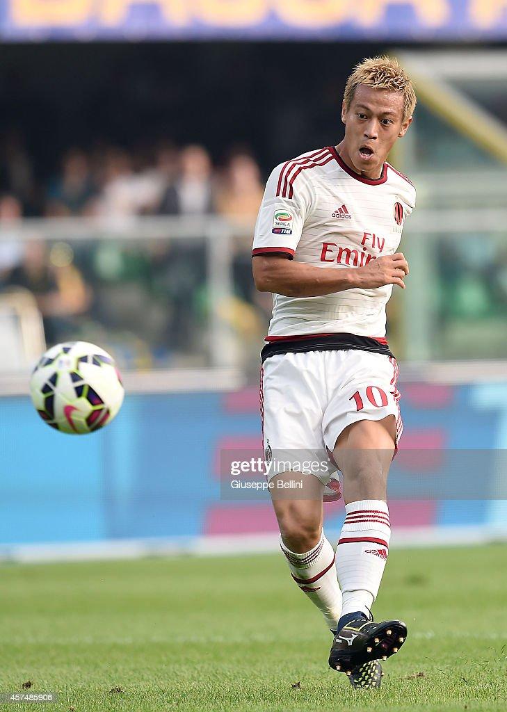 Keisuke Honda of Milan scores the goal 0-2 during the Serie A match between Hellas Verona FC and AC Milan at Stadio Marc'Antonio Bentegodi on October 19, 2014 in Verona, Italy.