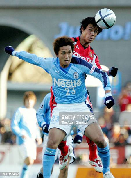 Keisuke Honda of Nagoya Grampus Eight and Takashi Fukunishi of Jubilo Iwata compete for the ball during the JLeague match between Jubilo Iwata and...