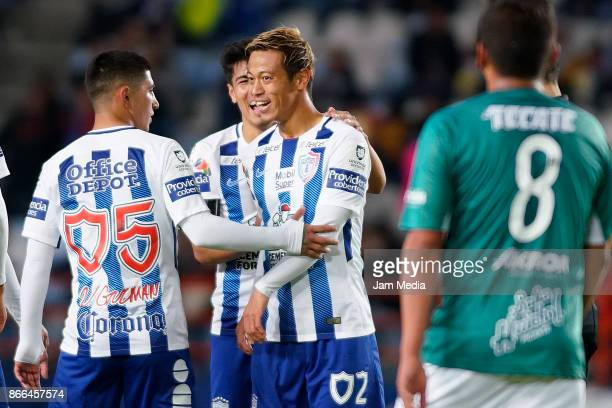 Keisuke Honda of Pachuca celebrates with teammate Victor Guzman after scoring the third goal of his team during the round of sixteen match between...