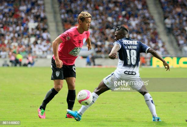 Keisuke Honda of Pachuca fights for the ball with Aviles Hurtado of Monterrey during the 13th round match between Monterrey and Pachuca as part of...