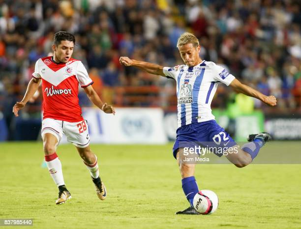Keisuke Honda of Pachuca shots on target and scores the fourth goal of his team during the sixth round match between Pachuca and Veracruz as part of...