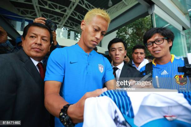 Keisuke Honda of Pachuca signs an autograph to a fan after a press conference to unveil Pachuca's new signings at Universidad del Futbol y Ciencias...