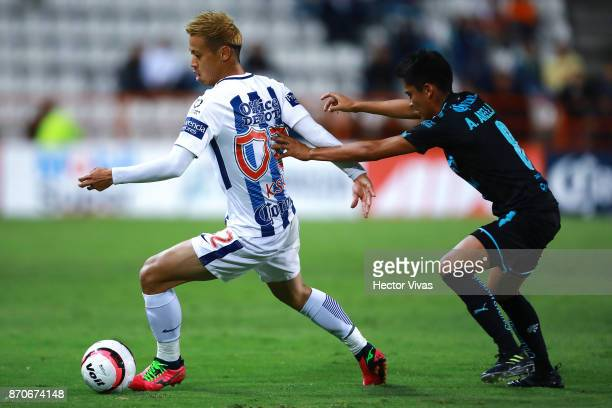 Keisuke Honda of Pachuca struggles for the ball with Aldo Arellano of Queretaro during the 16th round match between Pachuca and Queretaro as part of...