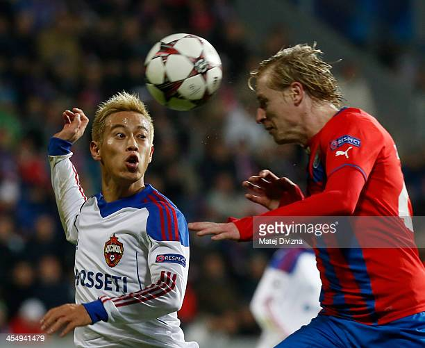 Keisuke Honda of PFC CSKA Moscow battles for the ball with Frantisek Rajtoral of Plzen during the UEFA Champions League group D match between PFC...