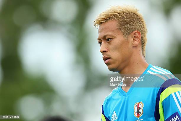 Keisuke Honda watches on during a Japan training session at North Greenwood Recreation Aquatic Complex on June 1 2014 in Clearwater Florida
