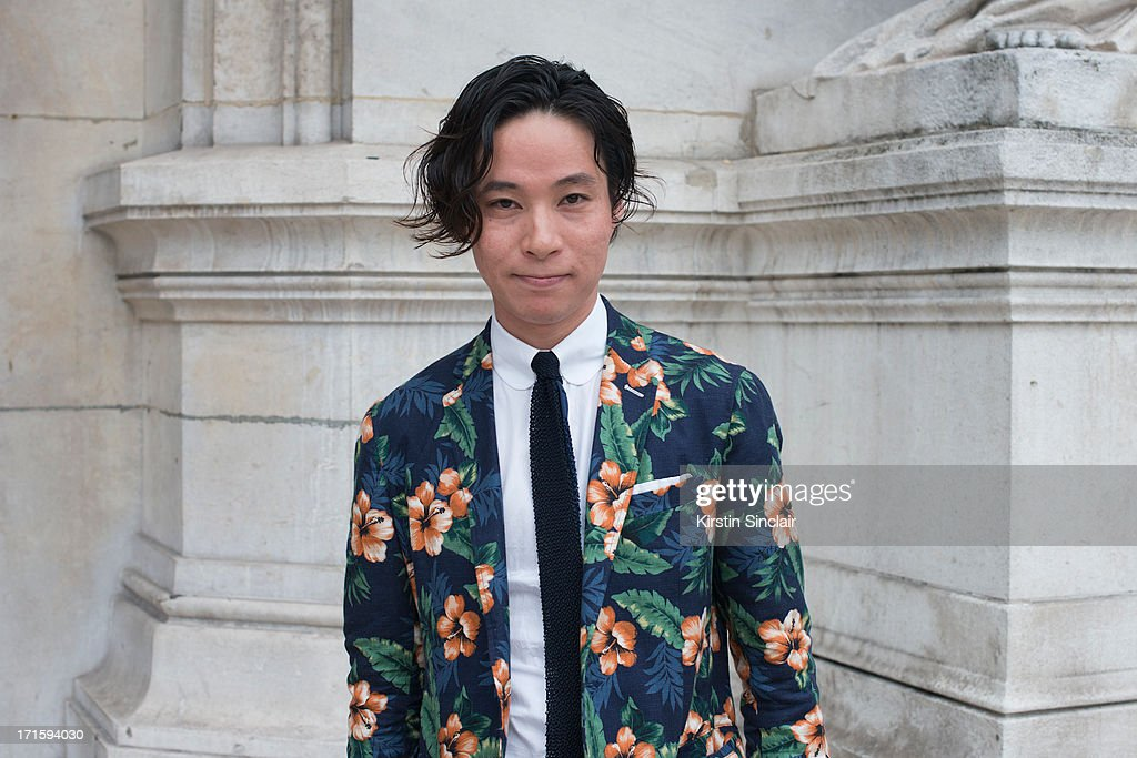 Keisuke Ikeya wears a United Arrow suit and shirt and a Steven Alan tie on day 1 of Paris Collections: Men on June 26, 2013 in Paris, France.
