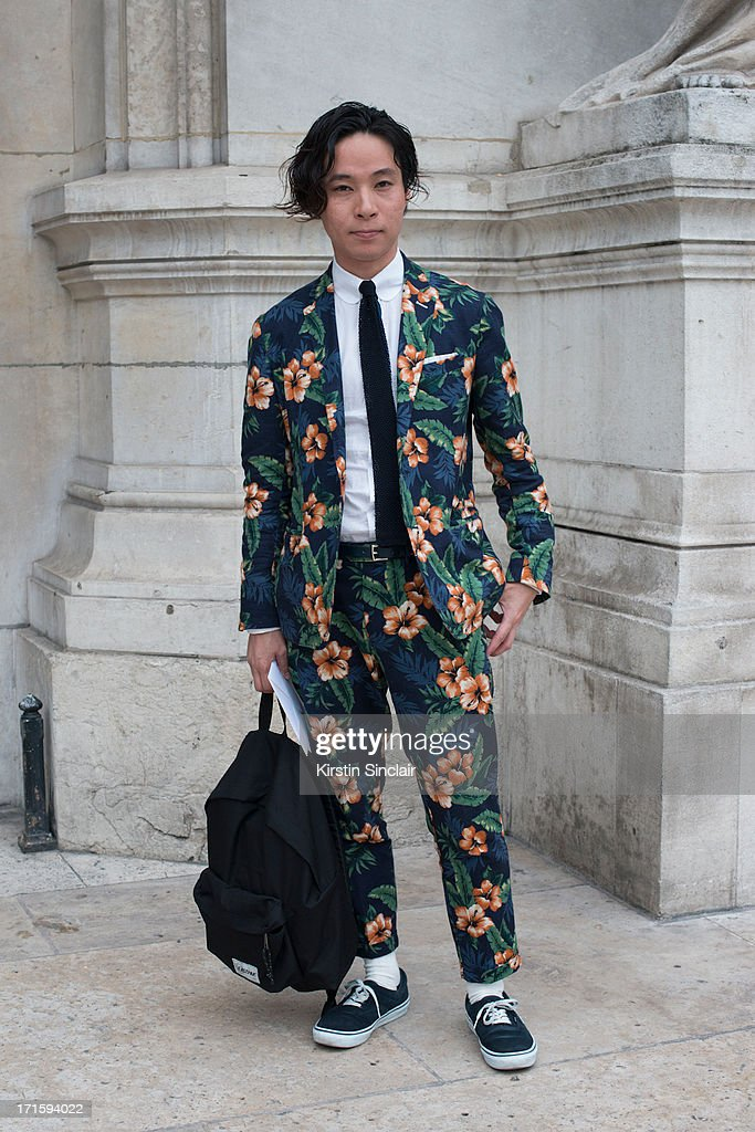 Keisuke Ikeya wears vans trainers, a United Arrow suit and shirt and a Steven Alan tie on day 1 of Paris Collections: Men on June 26, 2013 in Paris, France.